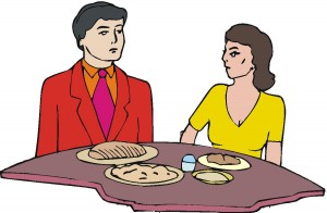 Man and woman eating restaurant meal