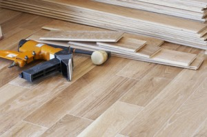 Wood flooring being installed with tools lying on floor