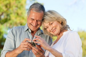 Mature couple looking at calculator