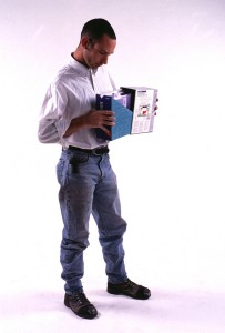 Standing man holding software box