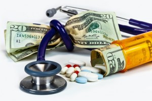 Stethoscope tied in a knot around a fist full of money