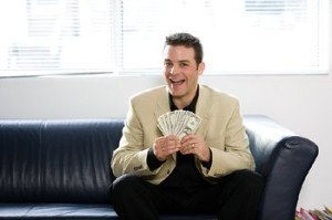 happy man holding money