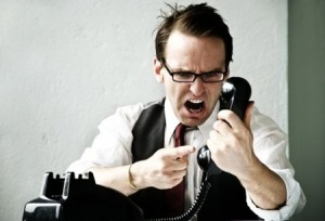 man shouting at the phone