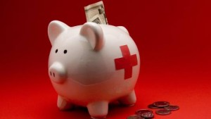 piggy bank with red cross