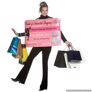 woman wearing a credit card and holding shopping bads