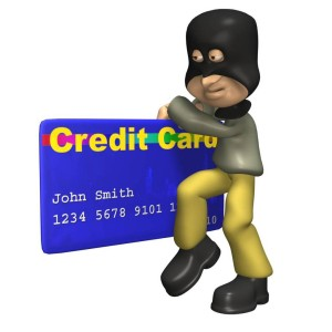 thief holding a credit card