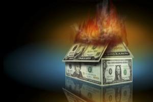 burning house made of cash