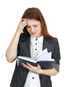 young woman looking at a notebook