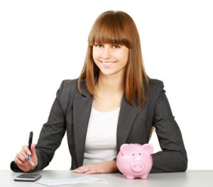 woman with a piggy bank and calculator