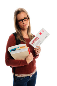 student holding envelop