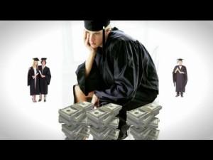 sad graduate sitting on top of money