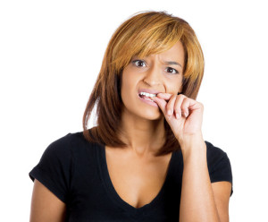 anxious woman biting her nails