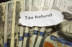 Tax Refund paper text on assorted cash