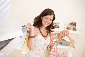 Happy woman holding shopping bag