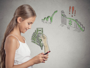 Girl holding a smartphone making money transactions