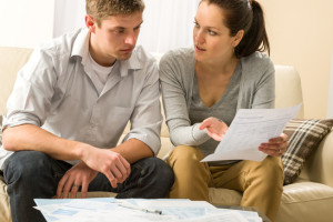 Worried couple talking about their expenses