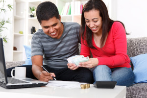 Smiling young couple budgeting