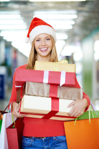 Happy woman with gift boxes and shopping bags