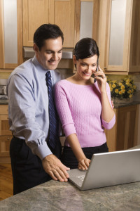 Happy couple in front of a laptop