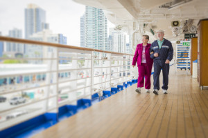 Happy Senior Couple Walking The Deck of a Luxury Passenger Cruise Ship.