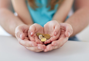 coins on hands