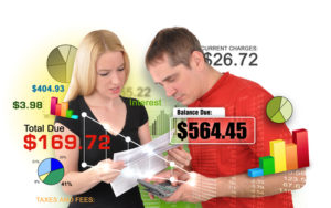 A young man and woman couple are looking at bills and calculating payments