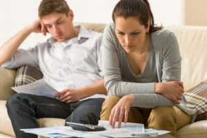 couple calculating their finances