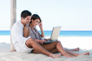 Happy smiling couple surfing the net
