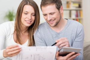 Young couple setting financial targets for the year