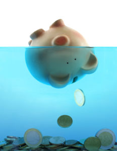 5 Spending Habits That Will Keep You Drowning In Debt